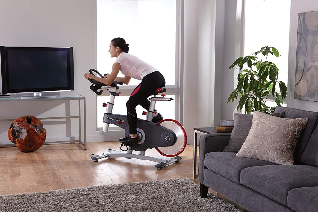 girl with exercise bike